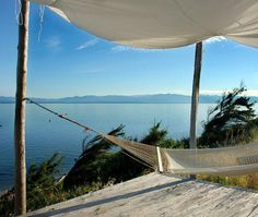 Porches take up much-needed space in tiny houses, but one with a hammock is required in my daydream home. A stunning view like this wouldn't go amiss, either!