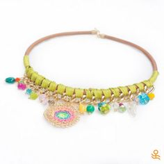 This bright necklace with crystals, semi precious stones and a wire wrap…
