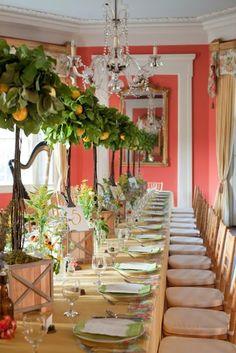 Elegant table arrangement inspired by nature. Loving the ornamental orange trees.