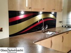 Bespoke glass splashback. Have you ever considered designing your own splashback from start to finish? This modern look was achieved by sandblasting two sleek stripes into the glass, then using a contrasting colour. If you are a bit creative, and want something that is totally unique, why not contact us by clicking the link below? Our creative team will work with you to create a design completely to your specification. http://glasssplashbacks.com/index.php/711-2/