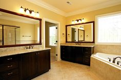 master bath - gold walls with dark cabinets/light counters and floors