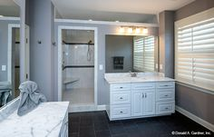 Separate vanities make it easy for couple to get ready in the morning! The Travis house plan #1350.