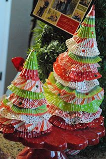 cupcake liner trees  I believe my grandma made one of these in white with white glitter and white lace around the edges.  my mom still gets it out every year....