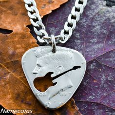 Guitar Pick Necklace, cut and burnished from half dollar, hand cut coi – NameCoins Guitar Pick Necklace, Ring Necklace, Dog Tag Necklace, Coin Jewelry, Jewelery, Unique Jewelry, Jewelry Ideas, Guitar Pick Art, Custom Guitar Picks
