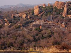 Big Cave Camp reposes atop an enormous granite whaleback with awesome views across the famous Matobo National Park. Sophisticated African architecture incorporates colossal boulders into a luxuriously appointed thatch lodge positioned amidst ancient Khoisan rock art.  #Awesomeness  Near Bulawayo, Zimbabwe.