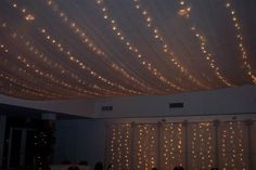 Wedding reception lighting.  Tulle and white christmas lights.