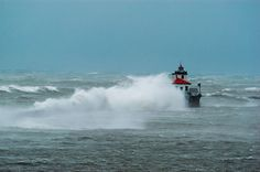 The Oswego Lighthouse is awash with waves during a November 2003 storm with 80 mph winds. Photo #8 by © 2003 Jon R. Vermilye via http://www.byways.org