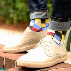 Statement Sockwear checkered design featuring the April Sock Color of the Month: Apple Red. Bold socks. Bold style.