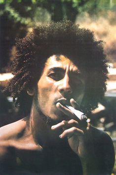worldwarxp:    High quality photograph of Bob Marley smoking a spliff in 1973. Later to be used as a alternative cover for his debut album called Catch a Fire for Island Records. The album would gain international fame and praises from reggae fans and critics.    Photographer:  Esther Anderson   This is amazing thank you