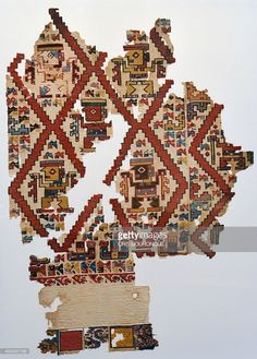 A fragment of a colorful 105 x 77 centimeters weaving, depicting personalities within rhomboidal spaces is displayed at the Art Museum of Lima (MALI) on June 11, 2014, part of an exhibit that brings together a representative selection of the pieces recovered from a noblewomans funerary chamber of the Castillo (Castle) of Huarmey, belonging to the pre-Inca Wari Culture (600-1000 BC), in central coastal Peru, 276 kilometers north of Lima, from an excavation initiated in 2012. From this…