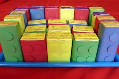 Lego Juice Boxes- cover with construction paper & glue piece of cardboard under the dots or use puffy two-sided tape.