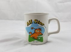 Check out this item in my Etsy shop https://www.etsy.com/listing/516166855/garfield-all-star-golfing-1978-ceramic