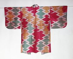 "Japanese Vintage Textile Meisen Haori with traditional geometric pattern called ""matsukawa-bishi"" which is weft kasuri. Meisen is a plain weave silk cloth whose patterns are checks, stripes, weft kasuri, warp kasuri and double kasuri. The word kasuri means ikat. Meisen is woven of second grade silk threads so that it was worn as a daily kimono. They have bold and modern designs comparing with formal kimonos. The lining is plain weave silk with beautiful katazome (stencil-dyeing) flower…"