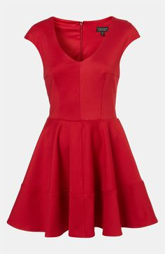 Totally rocks your curves! Topshops' skater dress in lipstick red is the understated, flirty, man-killer dress that flatters in comfort!