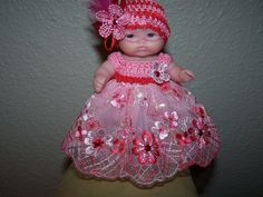 # 504 Pink/Red Lace dress with netting on hat.