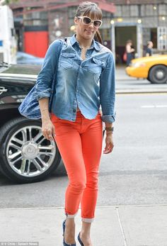 Orange is the new black: Paula Patton donned a pair of tangerine trousers as she stepped out in New York on Friday