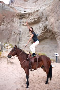 the horse does not look enthused by Jared's shenanigans