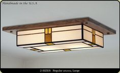 If you have low ceilings here is a great decorative mission style light.  Each light is custom made, you can select glass and wood colors to match your home.  http://www.missionstudio.com/products/mission-style-ceiling-light-fixture-709
