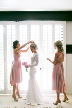 Bridesmaids helping the Bride with finishing touches: http://www.stylemepretty.com/california-weddings/palm-springs/2014/09/16/glamourous-palm-springs-wedding-at-the-parker-palm-springs/ | Photography: Mi Belle Photography - http://mibelleinc.com/connect/