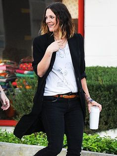 BABY TALK  Is she or isn't she? A possibly pregnant Drew Barrymore keeps photographers guessing Wednesday while out in West Hollywood.