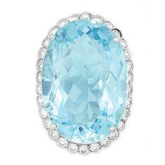 Aquamarine and Diamond Ring  White gold, one oval aquamarine ap. 37.00 cts., 30 diamonds ap. 1.80 cts., ap. 8.6 dwt.