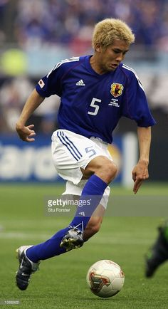 Junichi Inamato of Japan in action during the Japan v Tunisia, Group H, World Cup Group Stage match played at the Osaka-Nagai Stadium, Osaka, Japan on June 14, 2002. Japan won the game 2 - 0.