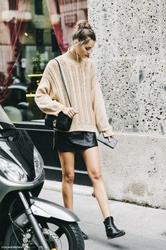 Turtleneck sweater with a leather mini and booties.