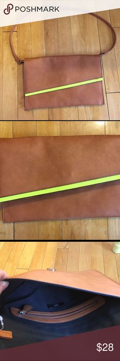 Oversized brown & neon clutch Super cute!! Can be just a clutch or a handbag. Lays flat. Flash of neon yellow with brown leather color. Mossimo Supply Co Bags Clutches & Wristlets