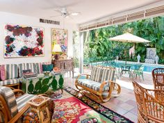vintage rattan furniture, bringing the outdoors in, elephant side table, colorful rug
