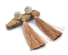Light brown and MOP tassel earrings Ethnic earrings Clip on earrings. These gorgeous light brown and MOP tassel earrings are very trendy! These ethnic and gypsy spirit long fringe earrings are a great gift for her! The light brown silk tassel gives them a nice Boho touch and they get lightness with the shell cabochon! This design make a great statement and can be wear all the year with your all outfits! #earrings #fashion #jewellery #jewelrydesign #girl #bohochic #bohojewelry #bohowedding