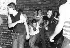 Jon Stewart Moshing at a 1982 Dead Kennedys Show  Photo taken by Irish Willis Peele of a young Jon Stewart (center) moshing at a Dead Kennedys and Front Line punk show at the Casablanca club in Richmond, Virginia. When the photo was snapped in July 1982, he was a student at William & Mary and went by his given name, Jon Leibowitz.