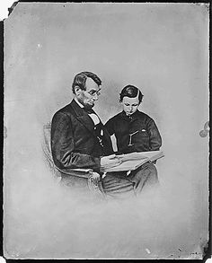 Father and son, sharing a book. Even a president in the middle of a war found time to read with his child.