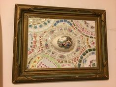 Mosaic with a egg cup lid from a trinket box in the centre