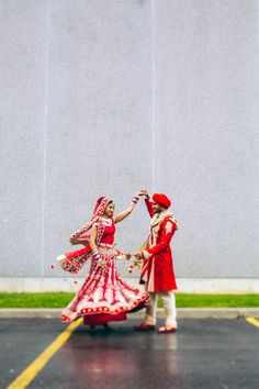 Sikh indian wedding bride and groom dancing in red and gold lehnga and sherwani by Nimboo Photography via http://www.indianweddingsite.com/james-bond-themed-indian-wedding-south-asian-wedding-centre/