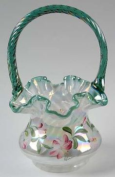 FENTON ART GLASS FLORAL MOTIF GREEN HANDLED & RIMMED BASKET.