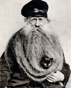 c. 1904. Louis Coulon the owner of 3.3-meter-long beard that could hold his cat.  #beard #man #French #Frenchman #long #cat #animal #wow #historyinpictures #historicalpix by historicalpix