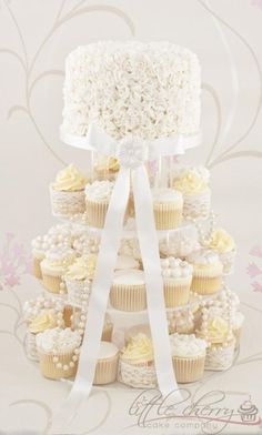 Weddbook is a content discovery engine mostly specialized on wedding concept. You can collect images, videos or articles you discovered organize them, add your own ideas to your collections and share with other people - Ivory Ruffle Cupcake Tower, for her bridal shower cupcake #Cupcake