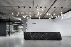 Humà Design has designed a new office space for SSENSE located in Montreal, Quebec. Situated at the top of 333 Chabanel in Montreal, the new SSENSE office Reception Design, Office Reception, Reception Areas, Black Reception Desk, Design Entrée, Lobby Design, Office Entrance, Office Lobby, Main Entrance