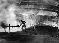 OCTOBER 10, 1951: A worker in the blast furnace at Bethlehem Steel Co. In the 1950s, the Sparrows Point plant in Baltimore County was the world's largest steel mill. (Robert F. Kniesche/Baltimore Sun)