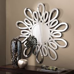 Add a little personality to your home with this wall mirror. with its beautiful design and reflective surfaces, it's bound to become the focal point of any living area. Add interest and texture to a b