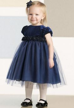 Puff cap sleeve velvet and tulle baby dress features satin Empire waistband adorned with rolled rosettes and tie back sash, full tulle overlay skirt with built-in crinoline. Baby Blue Dresses, Girls Blue Dress, Gowns For Girls, Girls Party Dress, Little Girl Dresses, Baby Dress, Nice Dresses, Girls Dresses, Flower Girl Dresses