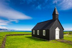 Budir church Iceland - The famous black church of Budir, West Iceland, in a wonderful landscape with green grass and blue sky. Click on the link or the image to buy a poster, fine art print or canvas print: http://matthias-hauser.artistwebsites.com/featured/budir-black-church-west-iceland-europe-matthias-hauser.html 30 days money back guarantee. (c) Matthias Hauser hauserfoto.com