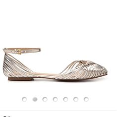 Silver flat sandal worn once. Rock two trends in one when you step out in this woven ankle strap flat from Report Signature. The two-piece Des is your guide to complete casual sophistication.   Woven faux metallic leather upper Ankle strap with an adjustable buckle Round toe Synthetic sole Imported View more Women's Report Signature Shoes Report Signature Shoes