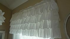 White ruffled curtains