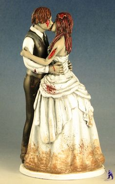 The Undead Happy Couple! Zombies kissing wedding cake topper by Garden Ninja Studios.