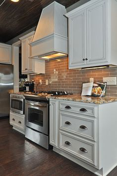 White Kitchen Cabinets. Similar layout.