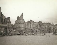 "Wrecked and burned buildings in France. The buildings were mined and burned by the Germans. ""Remains of a friendly little town, that was 'scorched'"", Show The Horrors Of The Nazi Retreat"