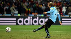 Diego Forlan scores for Uruguay in the penalty shoot out in the 2010 World Cup game against Ghana
