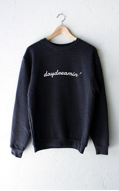 - Description - Size Guide Details: Super soft 'Daydreamin' oversized crew neck fleece sweatshirt in dark heather grey by NYCT Clothing. Oversized, Unisex fit. 50% Cotton, 50% Polyester. Made in USA.