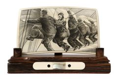 Trying to Beat the Oncoming Storm. Artist, Jim Pauls. Ancient Mammoth Tusk Ivory. Stand is Brazilian Rosewood, ebony, abalone and Ancient Mammoth Ivory.
